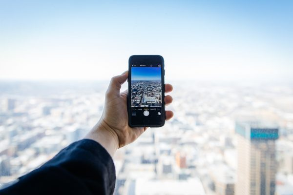 mobile phone takes photo of city