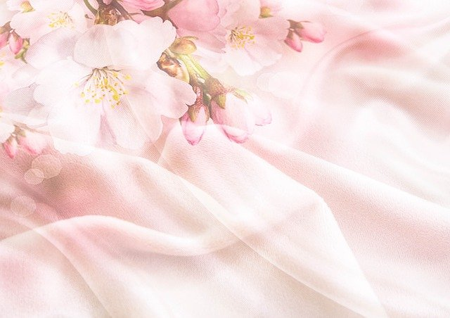 Pink silk fabric with a floral pattern.