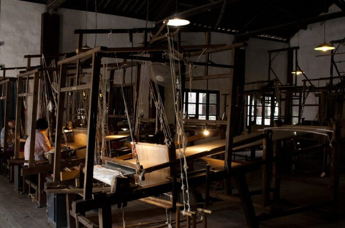 Old-time Chinese silk weaving workshop.