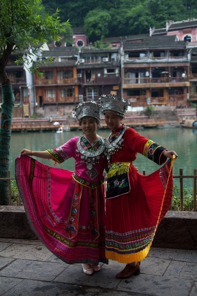 women in traditional outfits fenghuang