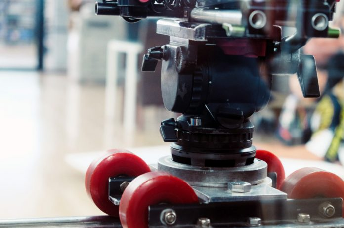 Close up view of dolly track for camera equipment.