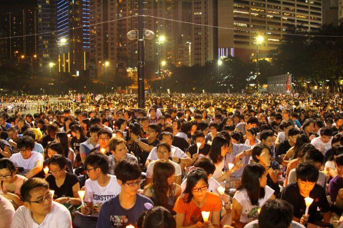Beyond race and boundaries - The people of Hong Kong mourning June 4th, as they have done faithfully for the past 32 years.