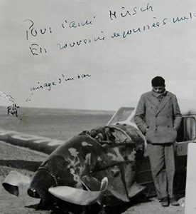 Antoine de Saint-Exupéry standing next to his plane after it crashed in the Sahara Desert in 1935.