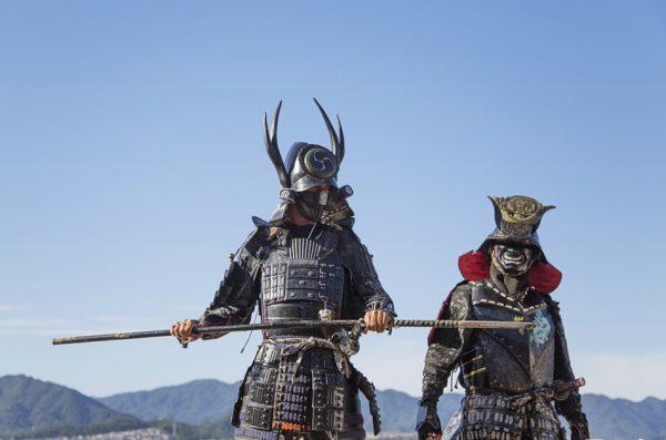 Two men dressed in Samurai armor at Itsukushima Shrine on Muyajima island, Japan.