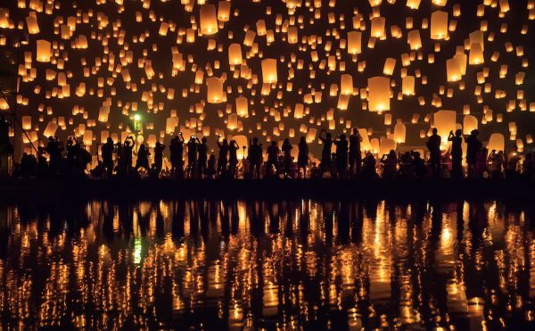 The warm orange glow of lanterns being sent up into the sky for the Yi Peng Festival in Chiang Mai, Thailand