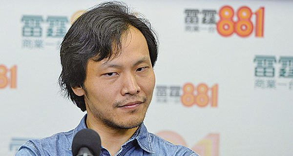 """Ying Liang, Chinese film director of the semi-autobiographical """"A Family Tour"""" giving an interview."""