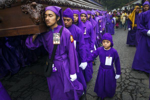 men wearing purple robes during holy week