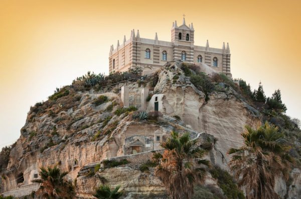 Sitting atop a cliff, the Cathedral of Santa Maria del Isola, Tropea, Italy.