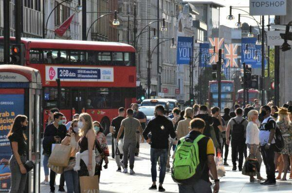 Crowd of people, some wearing protective face masks, on Oxford Street, London, United Kingdom in September 2020.