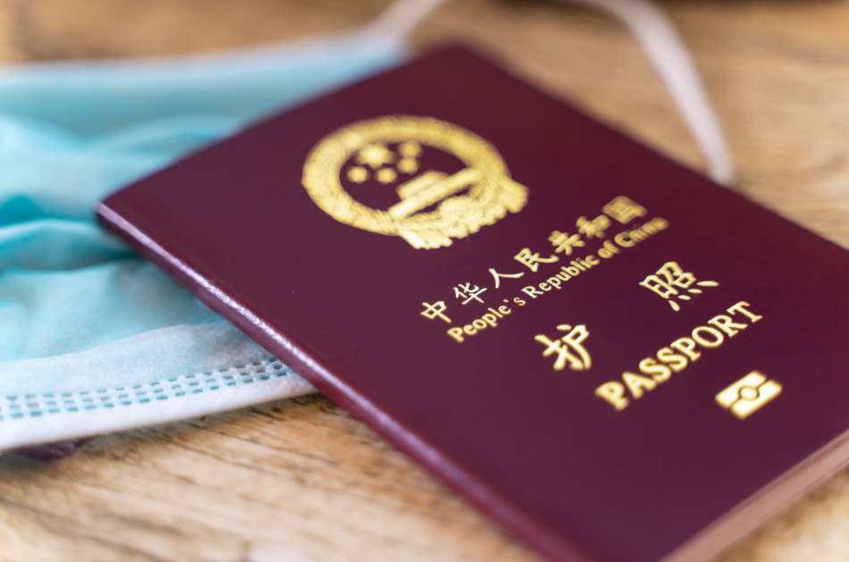 Close up view of chinese passport and face mask.