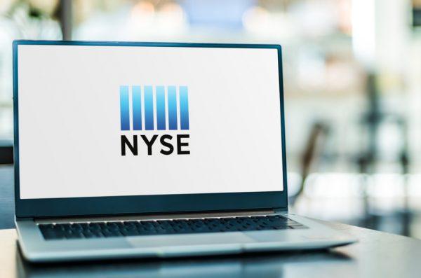 Laptop computer displaying logo of The New York Stock Exchange.
