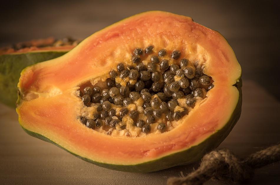 Half of a sliced papaya.