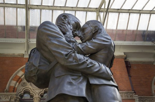 The Embracing Couple statue by Paul Day at the Meeting Place St. Pancras International Railway Station, London, England.