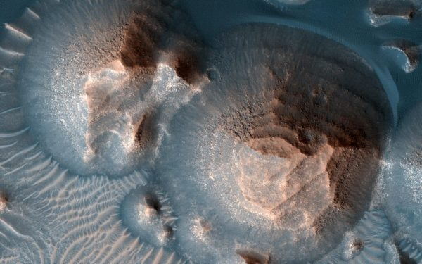 The photo shows evidence of ancient volcanic eruptions on Mars from a supervolcano.