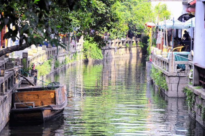 A tourist boat moored on the water canals within Tongli Town scenic area in Jiangsu Province China.